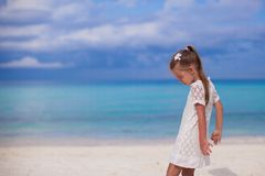 Cute little girl walking on tropical beach Royalty Free Stock Photos