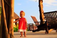 Cute little girl walking in tropical resort Stock Photos