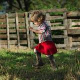 Cute little girl walks in village Stock Photo
