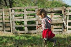 Cute little girl walks in village Royalty Free Stock Photo