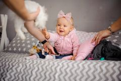 Cute little girl wants to play with white rabbit royalty free stock photography