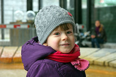 Cute little girl. In warm clothes smiles royalty free stock photo