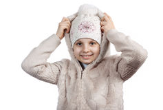 Cute little girl in warm clothes on white background Stock Images