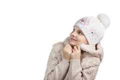 Cute little girl in warm clothes on white background Stock Photography