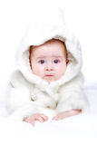Cute little girl with a warm coat on Stock Photo