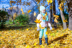 Cute little girl at warm sunny autumn day outdoor Royalty Free Stock Photography