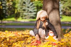 Cute little girl at warm sunny autumn day outdoor Stock Photos