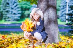 Cute little girl at warm sunny autumn day outdoor Stock Image