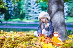 Cute little girl at warm sunny autumn day outdoor Royalty Free Stock Image
