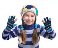 Cute little girl in a warm sweater and  cap Stock Images