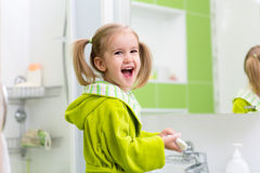 Cute little girl washing in bathroom Royalty Free Stock Images