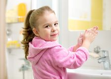 Cute little girl washing in bathroom Royalty Free Stock Photos