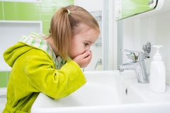 Cute little girl washing face in bath stock images