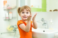 Cute little girl washing hands in bathroom Royalty Free Stock Photography