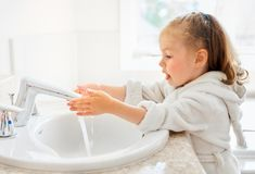 Girl is washing hands Royalty Free Stock Photography