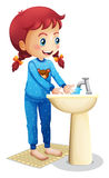 A cute little girl washing her face Stock Images