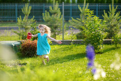 Cute little girl watering flowers Stock Images