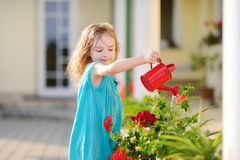 Cute little girl watering flowers Royalty Free Stock Photography