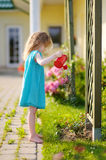 Cute little girl watering flowers Royalty Free Stock Image
