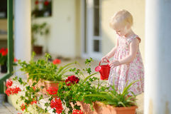 Cute little girl watering flowers Royalty Free Stock Photo