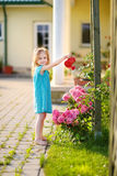 Cute little girl watering flowers Royalty Free Stock Photos
