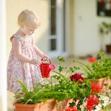 Cute little girl watering flowers Royalty Free Stock Images