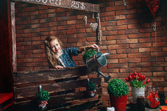 Cute little girl watering flowers at home Royalty Free Stock Photo