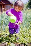 Cute little girl watering garden Royalty Free Stock Photography