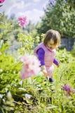 Cute little girl watering garden Stock Images