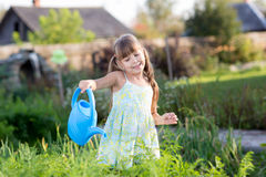 Cute little girl watering plants in the garden Royalty Free Stock Photography