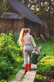 Cute little girl watering plants with watering can in  garden. C Stock Images