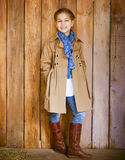 Cute little girl wearing autumn clothes Royalty Free Stock Images