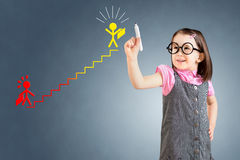 Cute little girl wearing business dress and drawing a career ladder concept. Blue background. Royalty Free Stock Photography
