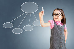 Cute little girl wearing business dress and drawing a flowchart 2. Blue background. Stock Images