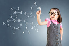 Cute little girl wearing business dress and drawing Social Network Concept. Blue background. Stock Photo