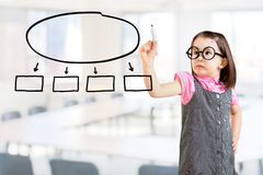 Cute little girl wearing business dress and drawing in a whiteboard. Office background. Stock Photography