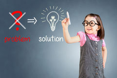 Cute little girl wearing business dress and eliminate problem and find solution. Blue background. Stock Photos