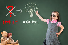 Cute little girl wearing business dress and eliminate problem and find solution on green chalk board. Royalty Free Stock Photography