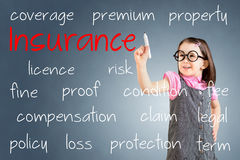 Cute little girl wearing business dress and writing insurance concept. Blue background. Royalty Free Stock Photos