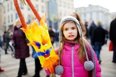 Cute girl wearing frightening masks during the celebration of Uzgavenes, a Lithuanian annual folk festival taking place seven week Stock Photo