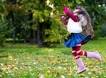 Cute little girl wearing fur coat in autumn forest Royalty Free Stock Images