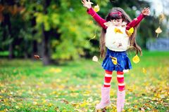 Cute little girl wearing fur coat in autumn forest Royalty Free Stock Photography