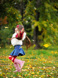 Cute little girl wearing fur coat in autumn forest Royalty Free Stock Photos