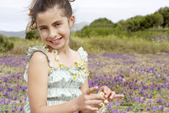 Cute Little Girl Wearing And Holding Necklace Of Flowers Stock Photography