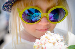 Cute little girl wearing mirrored round sunglasses Royalty Free Stock Images