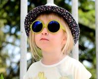Cute little girl wearing mirrored round sunglasses Stock Photo