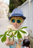Cute little girl wearing mirrored round sunglasses