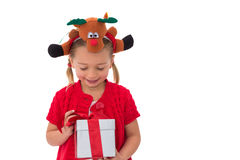 Cute little girl wearing rudolph headband Royalty Free Stock Images
