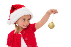 Cute little girl wearing santa hat holding bauble Royalty Free Stock Photography