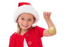 Cute little girl wearing santa hat holding bauble Stock Images